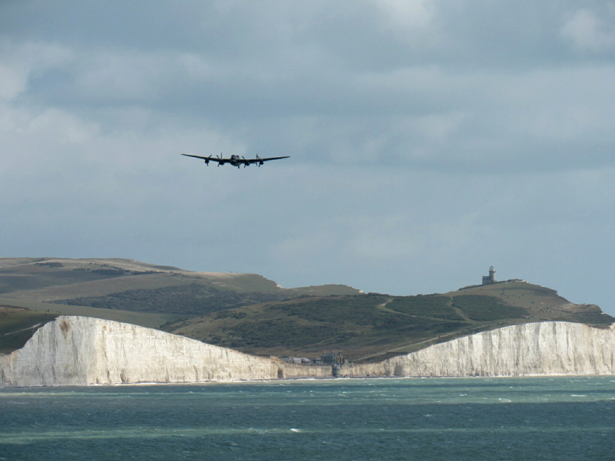A Lancaster bomber flying over Beachy Head.